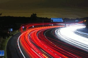High speed photo of busy highway at night