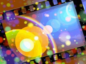 Image of film strip surrounded colorful light bubbles